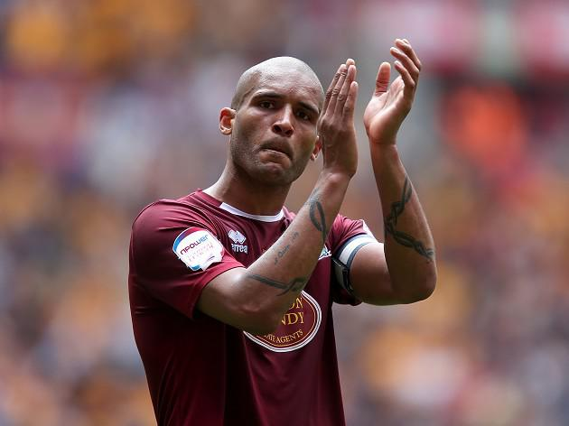Northampton Clarke Carlisle announces retirement