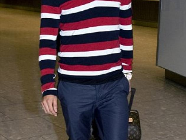 PICTURED: Tevez touches down at Heathrow as striker returns for Man City