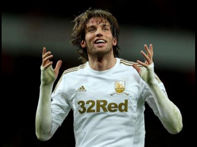 Swansea face anxious wait over Michu injury