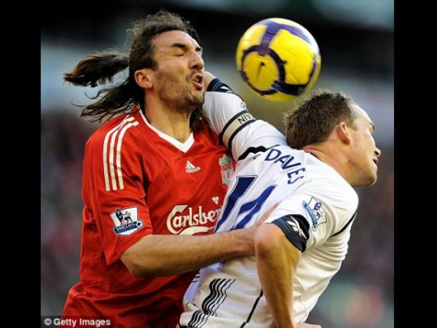 Liverpool's Kyrgiakos just loves those Premier League flying elbows