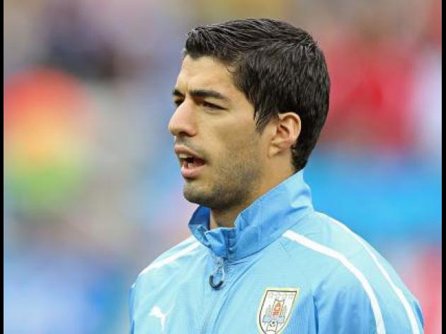 Adidas says will still work with Suarez