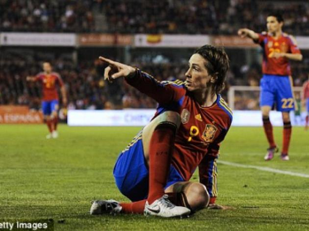 Fernando Torres's goal drought defended by Spain's Andres Iniesta