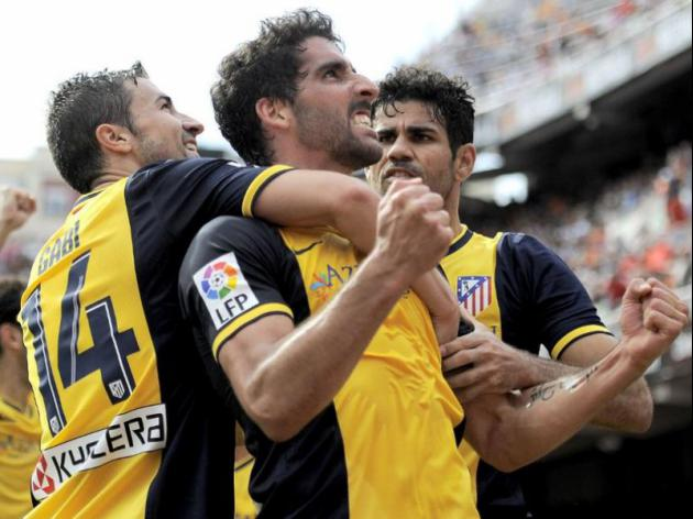 Atletico beat Valencia to edge towards title