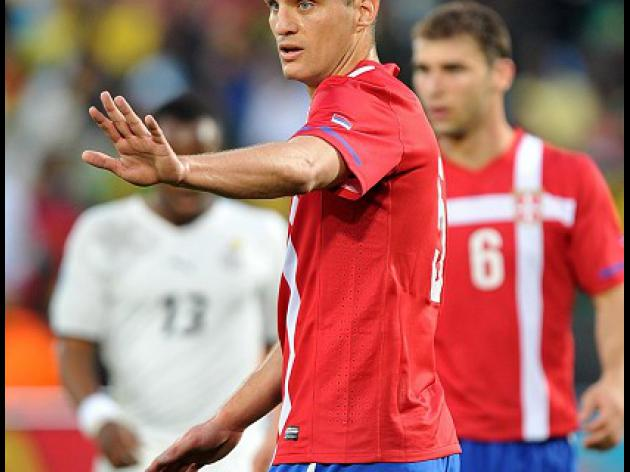 Vidic hangs up international boots