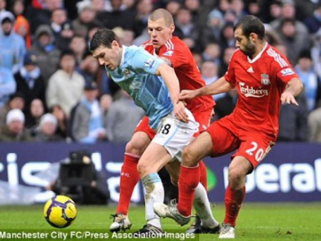 GRAHAM POLL: Mascherano's tackle on Barry is worth a five-match ban