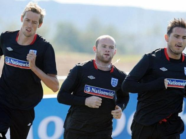 WORLD CUP 2010: The true size of the cross England star Wayne Rooney has to bear