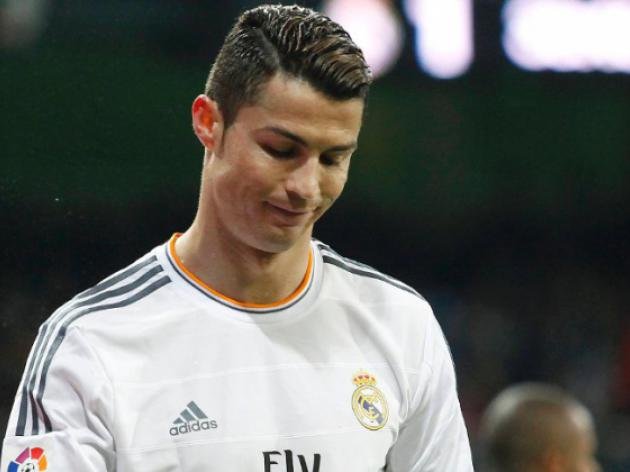 Ronaldo banned as three-way title chase hots up
