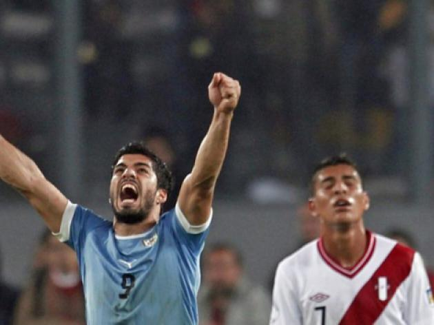 Suarez at the double as Uruguay down Peru