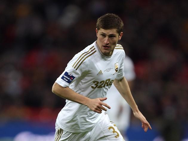 Swansea boss Michael Laudrup backs Davies for bright future