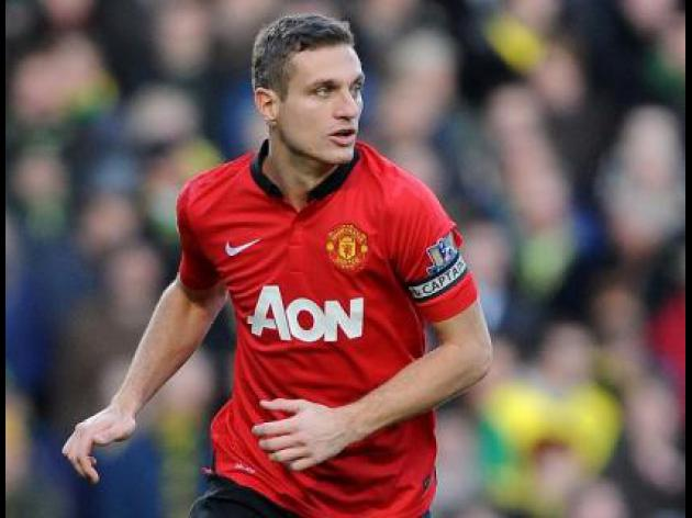 Vidic won't give up on title