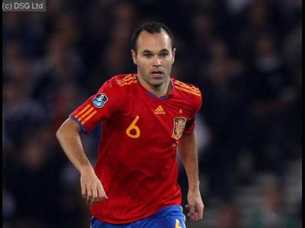 Iniesta back to face England