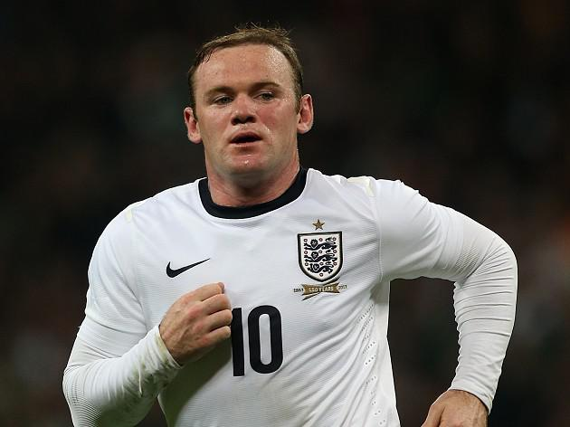 Rooney happy to be in England fold