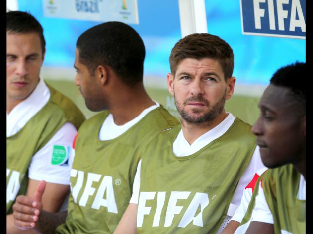 Steven Gerrard relaxes on beach with daughters after England's poor World Cup