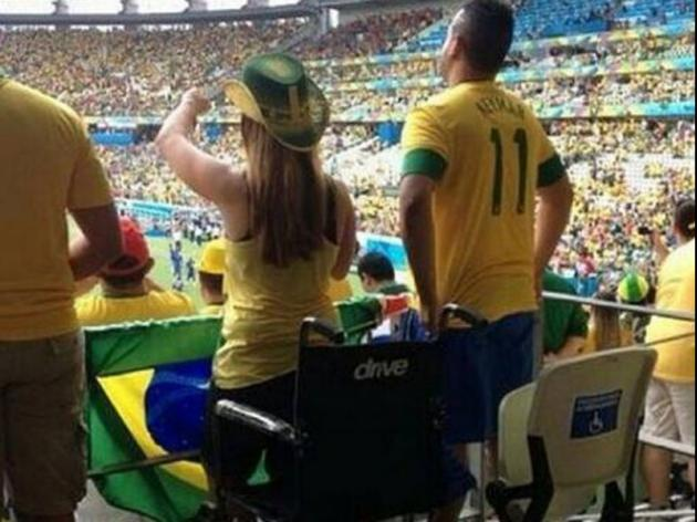 Controversy over picture of disabled Brazil fan standing