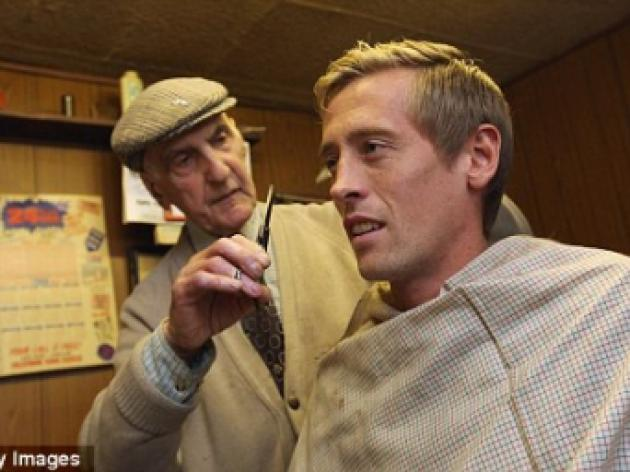 Snip, snip hooray! Crouch gets haircut from lifelong Spurs fan caught up in riots