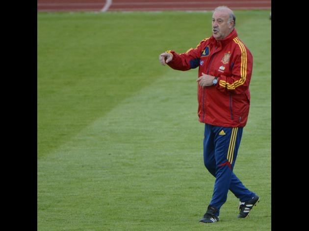 Spain coach promises joy in crisis