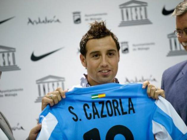 Cazorla and Joaquin help Malaga open their account