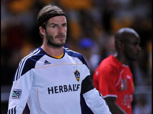 Beckham bides time on playing future