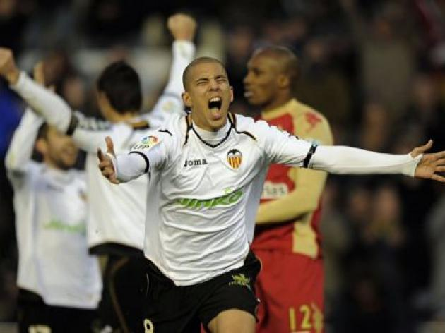 Valencia hit four to boost European hopes