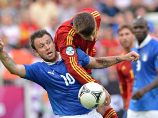 Italy hold Champions Spain to a draw