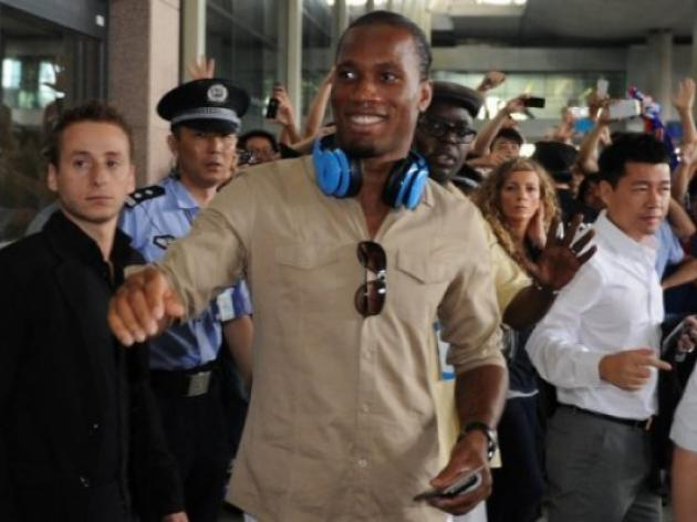 Drogba arrives in China to heros welcome