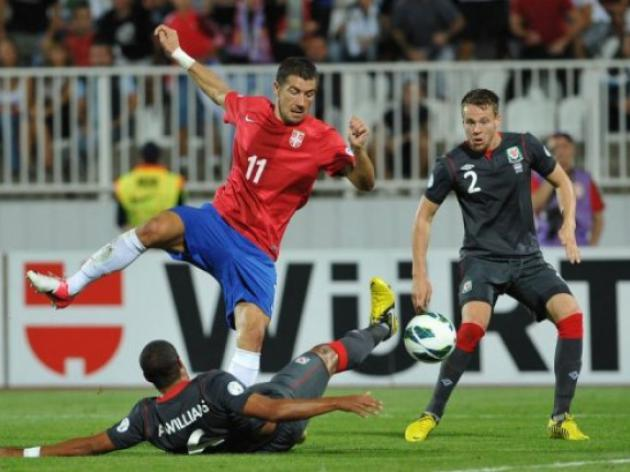 Serbia brush aside woeful Wales