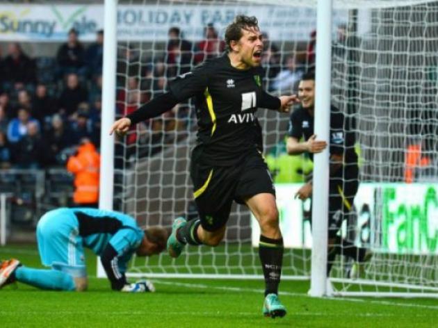 Norwich stun Swansea in seven-goal thriller
