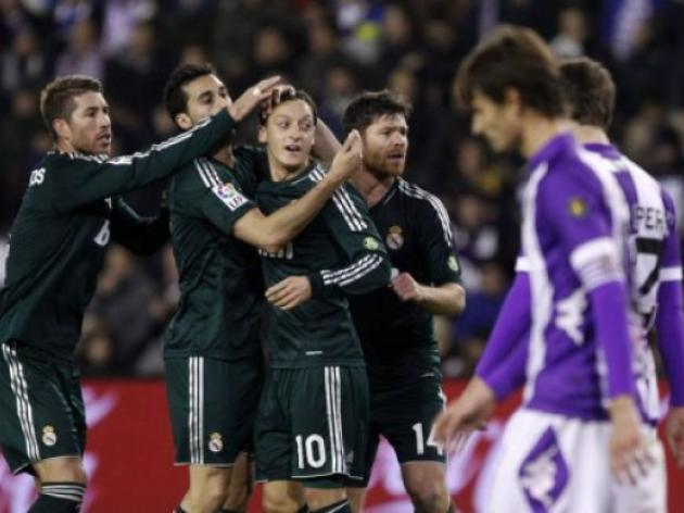 Ozil strikes twice as Madrid fight back for win