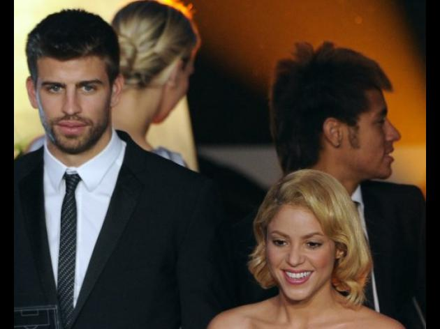 Pique irks media with Shakira birth prank