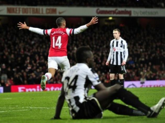 Walcott treble as seven-up Arsenal sink Newcastle