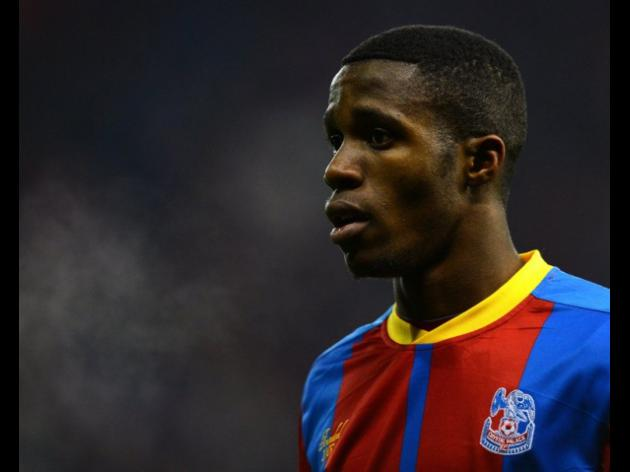 Englands Zaha admits charge over rude gesture