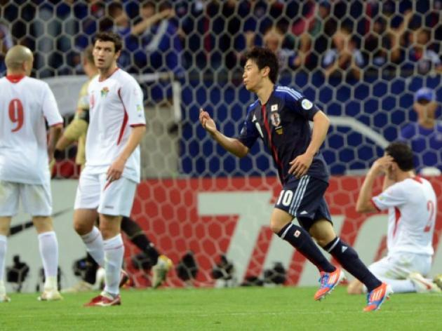 Rampant Japan poised to seal World Cup berth