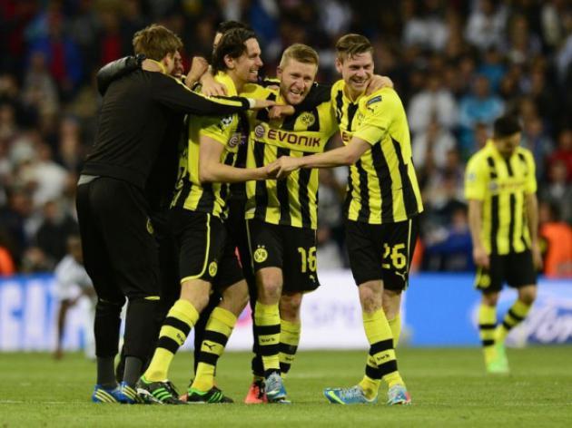Dortmund hold on despite late Real rally