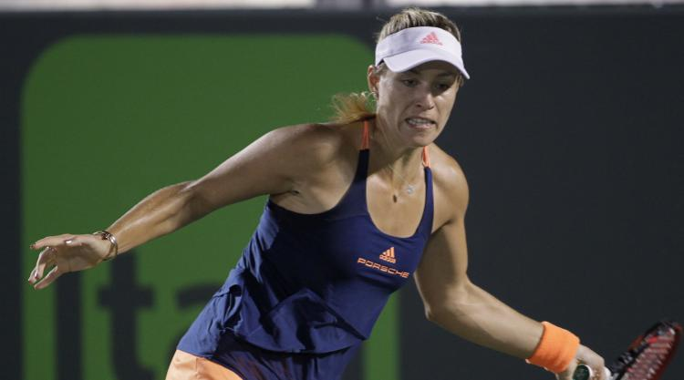 Kerber plays into the night to seal second-round place in Miami