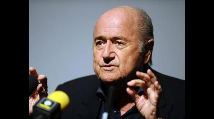 Blatter battered but not beaten