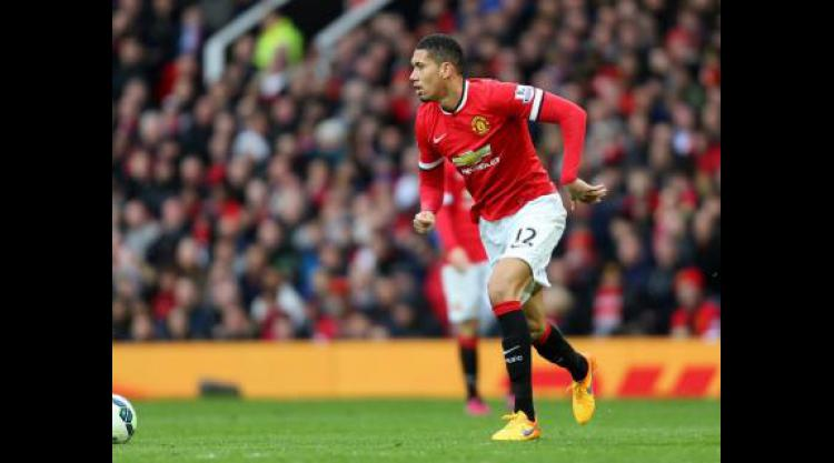 Smalling signs new United deal