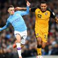 Manchester City's Phil Foden flouts social distancing in beach kickabout